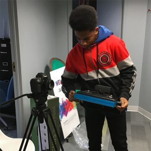 A SchoolTalk Arts to Advocacy youth learns about careers in photography