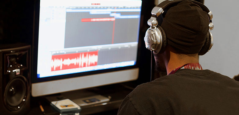 A student in SchoolTalk's Music Production & Career Development Program produces a song in our digital studio.